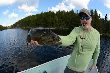A nice smallmouth from, what else, Bass Lake, one of 30-plus such bass we landed, all on poppers, that day.